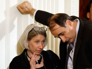 Anita Dunn and David Axelrod talking quietly..